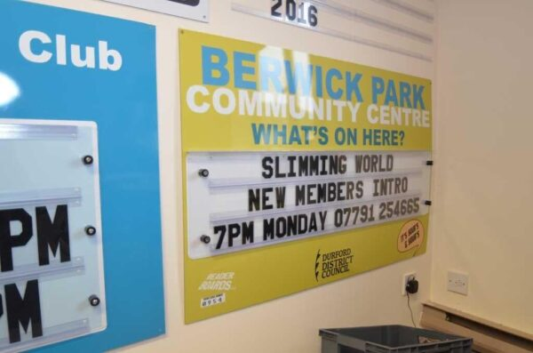 changeable sign for community notice board with 3 tracks of letters