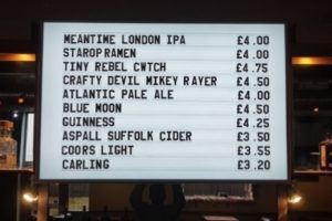displaying variety of vraft ales on a menu board that can be changed